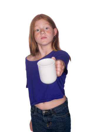 red head girl: young red head girl in purple shirt holding out cup towards the camera