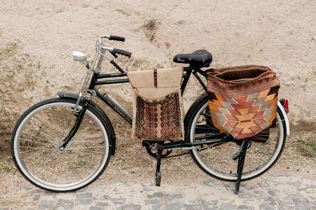 saddlebag: old vintage bicycle with handmade bag and saddlebags on display Editorial