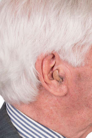 old man with hearing aid and ear hair Stock Photo - 27669551
