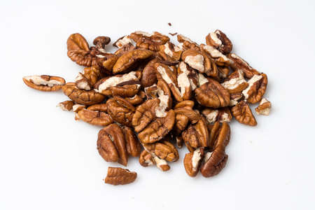 anti oxidants: Pecan nuts on a pile on a white background