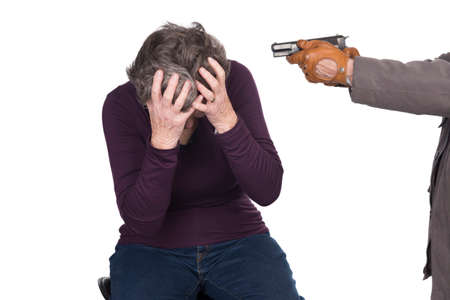 elderly woman under attack by knife or gun photo