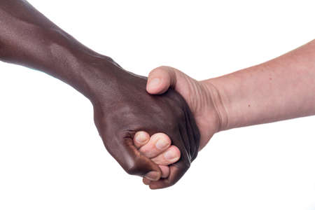 two males of different races holding hands Stock Photo