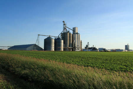 ethanol: Ethanol plant with Soybean field in forefront Stock Photo