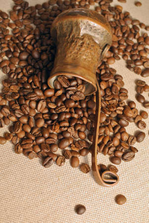 cezve: Coffee beans and vintage copper turkish coffee pot cezve or ibrik on the cloth sack