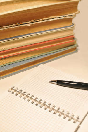 test deadline: Pen, notebook with blank pages and old books Stock Photo