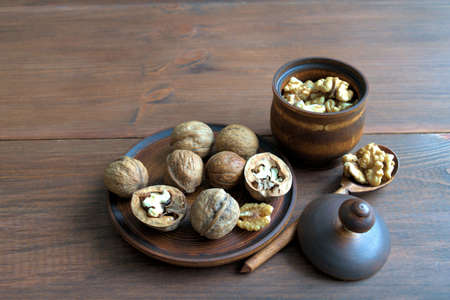 purified: Walnuts. Walnuts on a wooden plate. Kernels purified in a wooden bowl. Wooden spoon with kernels of walnuts.