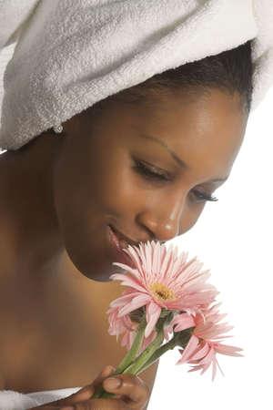 タオルと花を持つ女性 写真素材