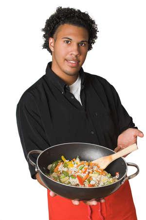 分離した鍋で若いシェフ 写真素材
