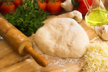 pin board: pizza dough and ingredients