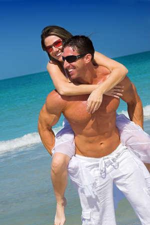 happy couple at the beach photo