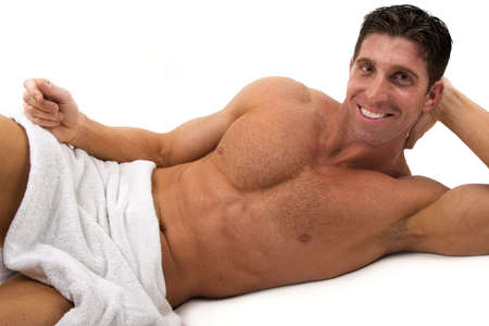 naked muscular man wearing only towel photo