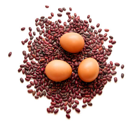 digesting: Tree eggs on red beans on white background Stock Photo