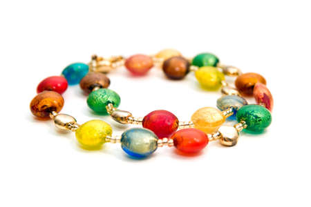 Necklace made of colorful beads isolated on white photo