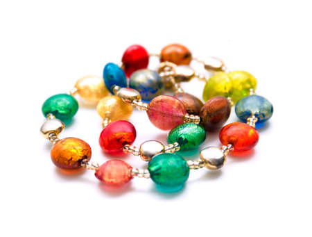 Colorful beads made of Murano glass isolated on white photo