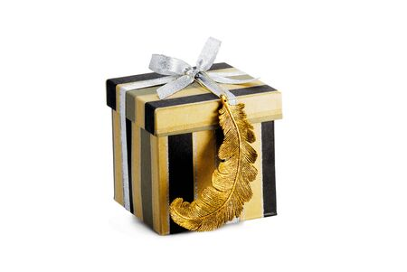 box for presents decorated with silver ribbon and golden feather  photo
