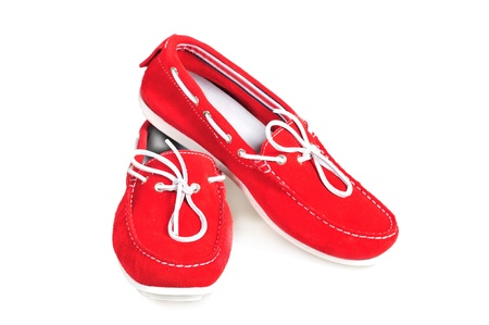 moccasins: pair of red moccasins isolated over white background