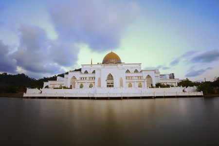 shah: Sunset at Sultan Ahmad Shah Mosque at International Islamic University Malaysia, Kuantan Pahang. Soft focus and nature composition to create smooth water  due long exposure Stock Photo