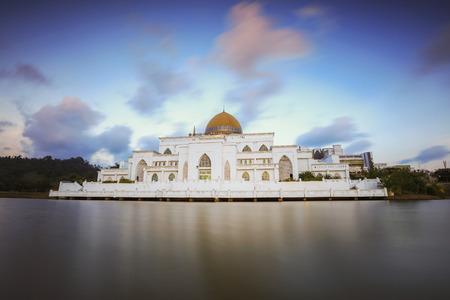 pahang: Sunset at Sultan Ahmad Shah Mosque at International Islamic University Malaysia, Kuantan Pahang. Soft focus and nature composition to create smooth water  due long exposure Stock Photo
