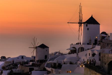 Windmills in sunset Stock Photo