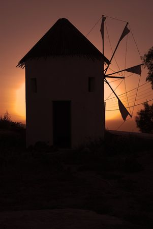 Windmill in sunset photo