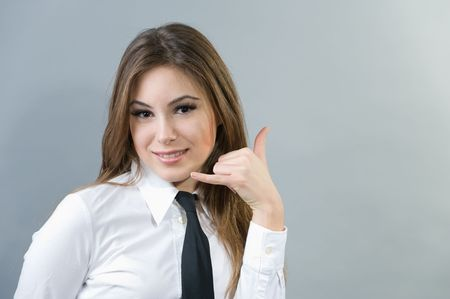 Beautiful woman making a call me sign Stock Photo - 4207653
