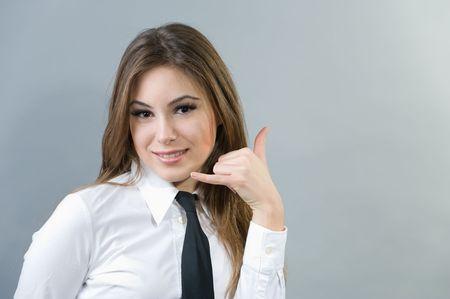 Beautiful woman making a call me sign Stock Photo - 4207653