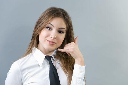call me: Beautiful woman making a call me sign