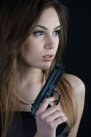 Beautiful woman with gun photo
