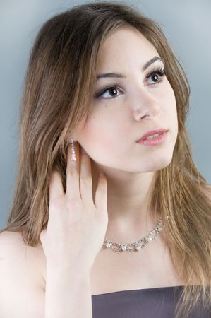 Beautiful woman with touching her earring Stock Photo - 4207661