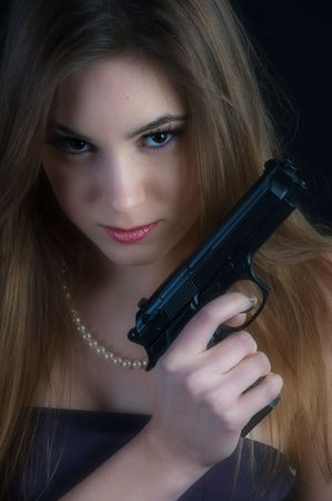 Dangerous woman with a gun Stock Photo - 4299729