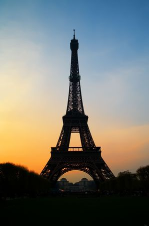 The Eiffel tower in Paris with beautiful sunset photo