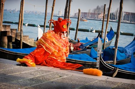 Clown by the gondolas in Venice
