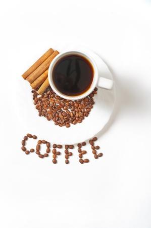 Mug of coffee with decoration on white background Stock Photo