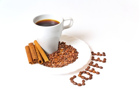 decaffeinated: Coffee beans with a white mug on white background