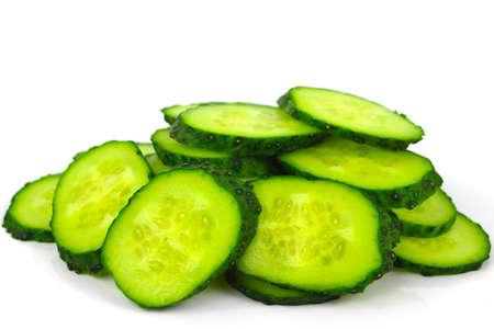 english cucumber: Fresh cucumbers sliced on a white background