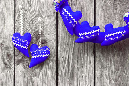 Navy blue hearts on a wooden background