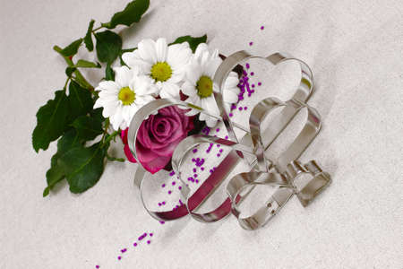Metal hearts and flowers photo