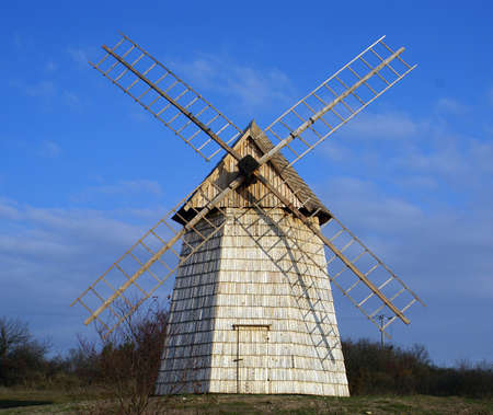 Old wooden windmill in open-air museum