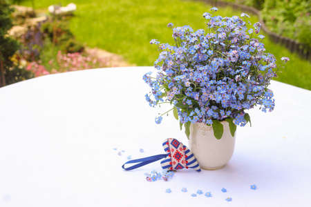 Bouquet of forget-me-nots on a white background