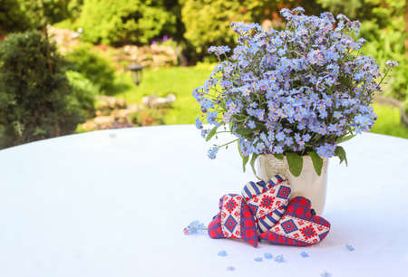 Three hearts with a bouquet of forget-me-nots on a white background Stock Photo