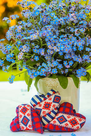 Three hearts and a bouquet of forget-me-nots