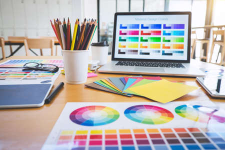 Graphic designer object tool and color swatch samples at workspace. Stock Photo