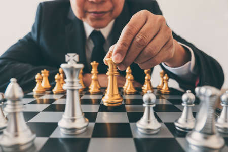 Businessman leadership playing chess and thinking strategy plan about crash overthrow the opposite team and development analyze for successful of corporate.