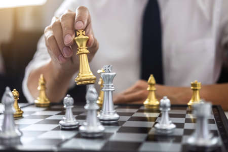 Planning and Strategic concept, Businessman playing chess and thinking strategy about crash overthrow the opposite team and development analysis for win and successful.