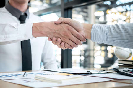 Finishing up a conversation after collaboration, handshake of two business people after contract agreement to become a partner, collaborative teamwork. Zdjęcie Seryjne