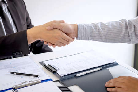 Successful job interview, Boss employer in suit and new employee shaking hands after negotiation and interview, career and placement concept.