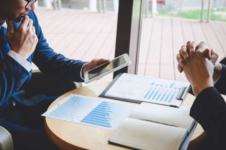 Professional executive manager, Business partner discussing ideas marketing plan and presentation project of investment at meeting and analyzing on document data, financial and investment concept. Stock Photo