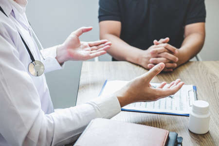 Doctor consulting with patient examining for patient, presenting results symptom about the problem and recommend treatment method, Healthcare and medical concept.