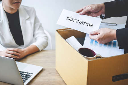 Businessman sending a resignation letter to employer boss in order to dismiss employment contract, changing and resigning from work concept.