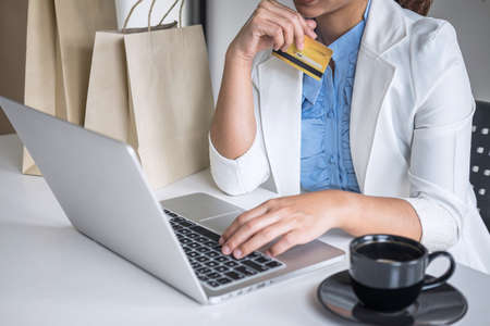 Business woman consumer holding credit card and typing on laptop for online shopping and payment make a purchase on the Internet, Online payment, networking and buy product technology.
